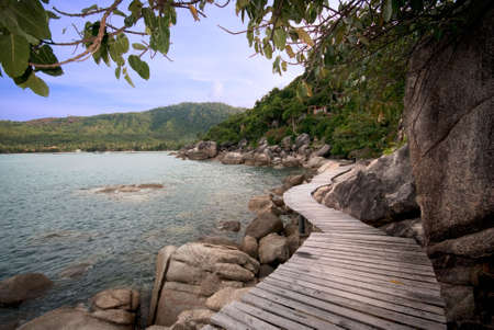boardwalk trail: footpath to a clear mountain lake Stock Photo