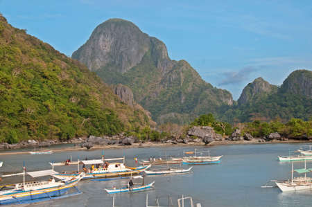 philippino: typical philippino boats in a bay. Stock Photo