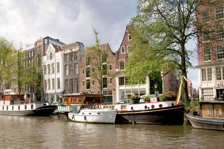 canal street: One of the Channels in Amsterdam with many boats.