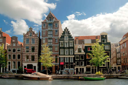 Amsterdam canals and typical houses with clear spring sky Stock Photo - 6611920
