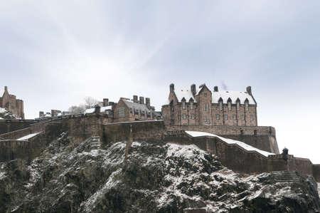 Edinburgh castle in winter snow Scotland, UK. photo