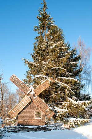 old wooden wind will covered with snow photo