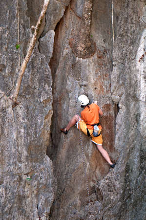 female mountain climber on the rock photo