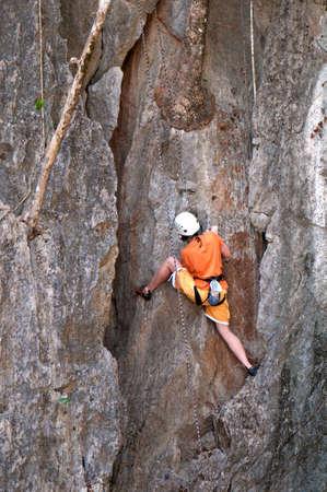 female mountain climber on the rock photo