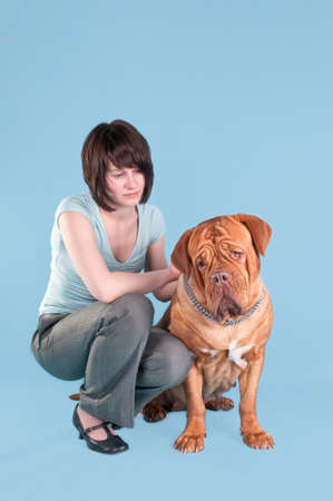 molosse: Young girl and her big dogue de bordeaux kneeling
