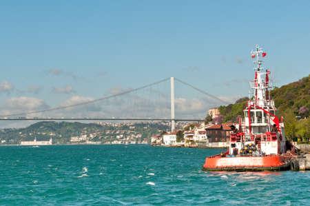 fatih: fatih sultan mehmet bridge and a ferry, Istanbul, Turkey
