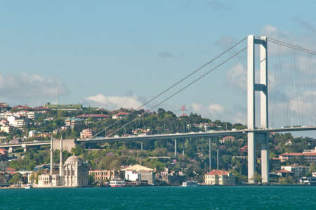 bosphorus: The Bosphorus bridge and Ortakoy  Mosque, view from a boat. Stock Photo