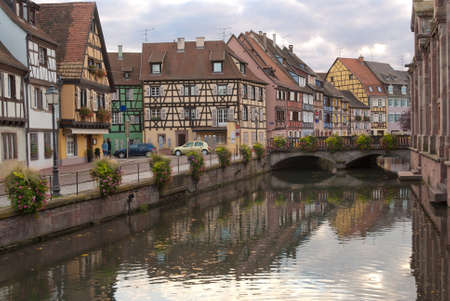 Channel and street with half-timbered houses in town Standard-Bild