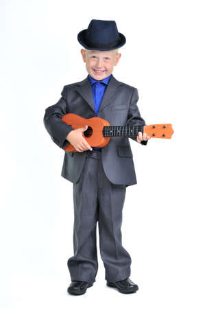 Smart Happy Boy in a Suit playing Guitar photo