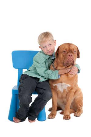 Little boy hugging its dog Stock Photo - 8125031