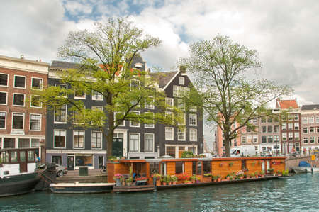 A Channel in Amsterdam- water house Stock Photo - 11707642