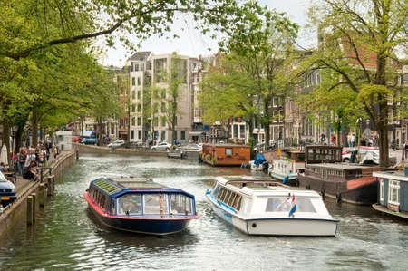 Boats in an Amsterdam Canal. Stock Photo - 11707645