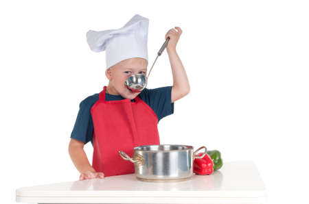 cheff: Little boy dressed like a cheff tasting the food he made