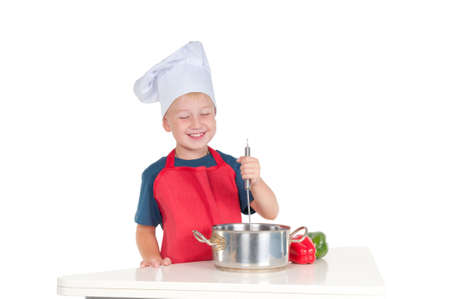Smiling young cook stirring  food photo