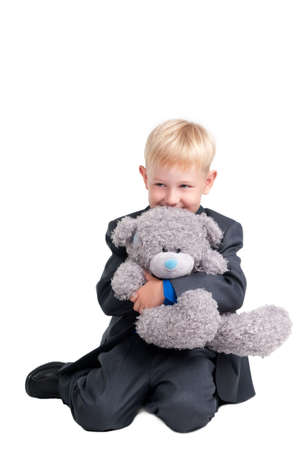 Young Boy with a Bear Toy photo