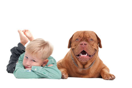 Small boy with dogue de bordeaux lying on the floor photo