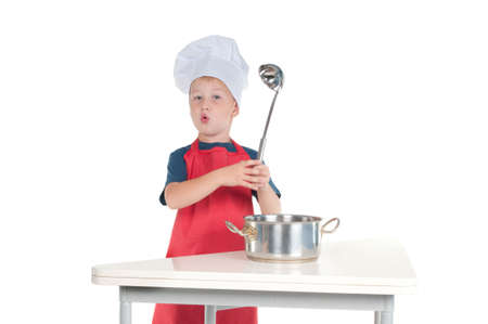 cheff: Little cheff explaining recipe holding the ladle in hand Stock Photo
