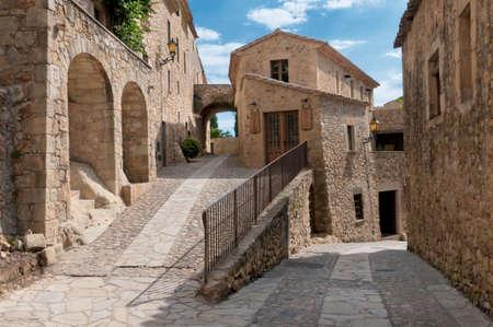 Lonely alley in Peratallada, Spain. photo