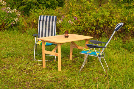 Infiting Garden Settings with a Table and two chairs photo