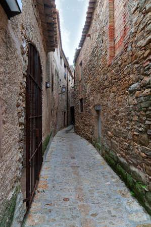passageway: Narrow passageway between two walls in Peratallada, Spain Stock Photo