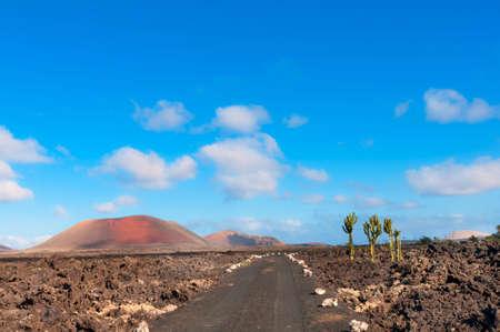 igneous: Arid dusty road on sunny day, Lanzarote Island, Spain Stock Photo
