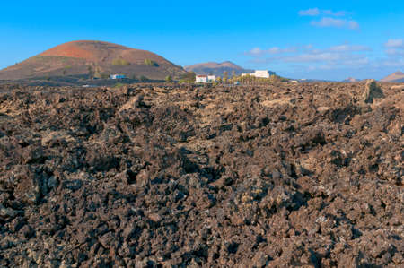 igneous: Volcanic soil landscape  with hill and villa on the back, Lanzarote Island, Spain
