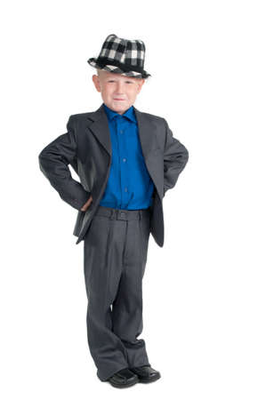 arms akimbo: Smiling young boy with chequered hat and suit Stock Photo