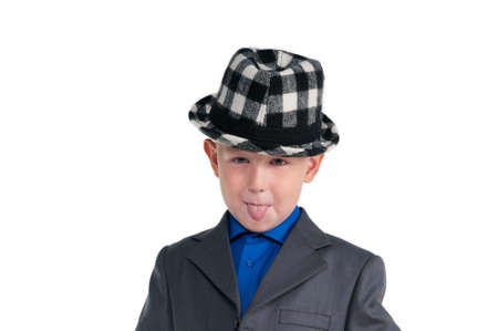 Small schoolboy with suit and hat making faces photo