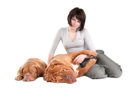 Young woman sitting on the floor with her two dogs photo