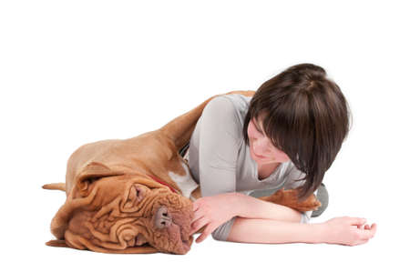 Young woman playing with her dog on the floor photo