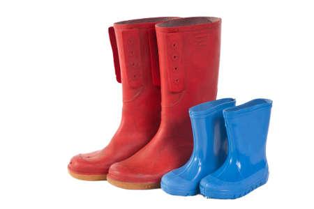 Pares de fotos de stock:Un grupo de botas de wellie aislado en un fondo blanco
