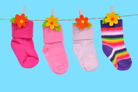 Four Colorful Socks Drying on a String photo