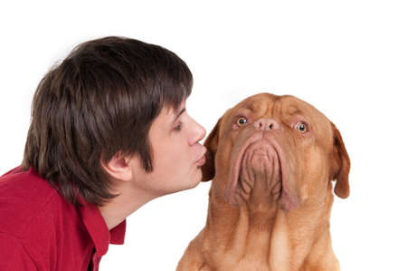 cheek: Young man giving a kiss to his lovely dog