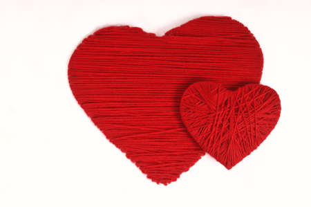 Two knit hearts - symbol of love isolated on white photo