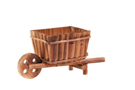 cart road: Handmade model of an wooden cart standing isolated on white background