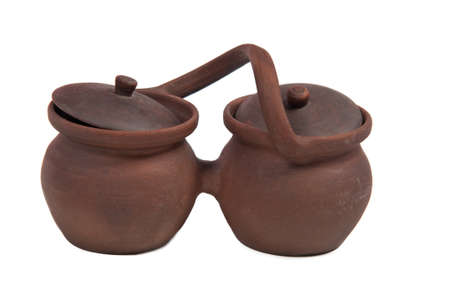 Two earthenware pots with handle and lids photo