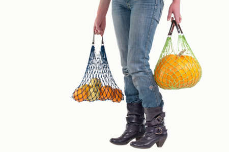 Woman with shopping bags carrying groceries isolated on white background Stock Photo - 8926952