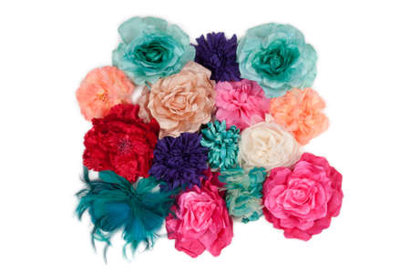Set of colorful artificial flowers isolated on white (girl barrettes with flowers) isolated on white photo