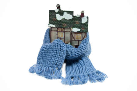 Winter toy house wraped in a shawl photo