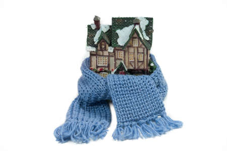 Scarf around a miniature small house (conceptual view of protecting or isolating house) photo