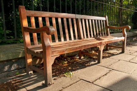 Wooden Park Bench with Memory Plate in the park shade in Edinburgh photo