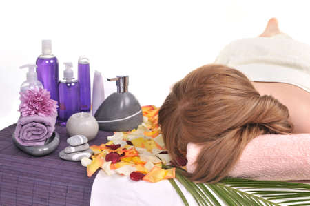 Beautiful woman getting spa treatment - relaxed young woman in a spa center photo