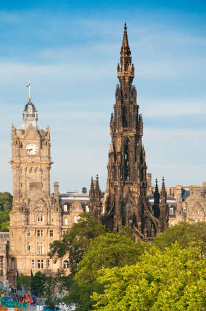 The Scott Monument and Balmoral (formerly North British) Hotel on Edinburghs Princes Street photo