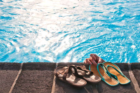Two pairs of slippers at the pool photo
