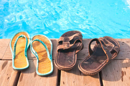 anniversary beach: Two pairs of flip-flops - mens and womens Stock Photo