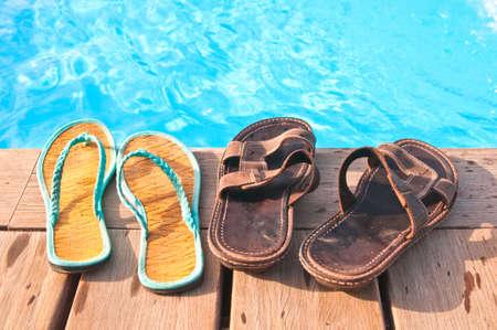 Two pairs of flip-flops - men's and women's Standard-Bild