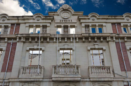 Facade of a beautiful customs building in repairs in Alicante, Spain. photo