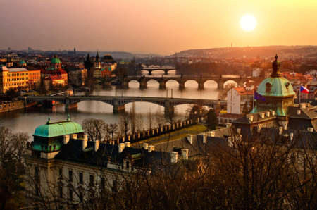prague castle: Panoramic view on Charles bridge and sunset Prague lights. Bohemia, Czech Republic