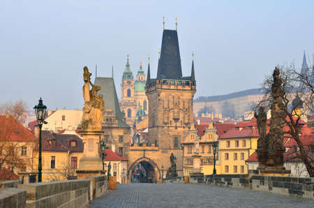 bohemia: View of the Lesser Bridge Tower of Charles Bridge in Prague (Karluv Most) the Czech Republic - oldest and a very popular tourist attraction Stock Photo