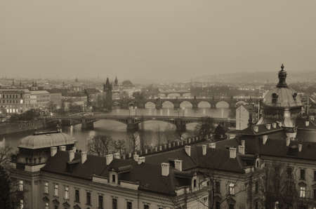 Old Sepia Styled View on Prague bridges at sunset photo